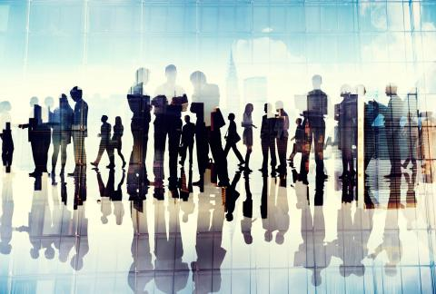 Silhouettes of business people networking at a C-suite conference