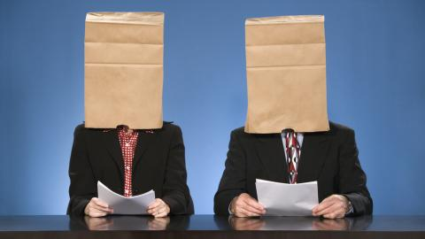 Man and woman with their faces covered to remove any recruitment bias