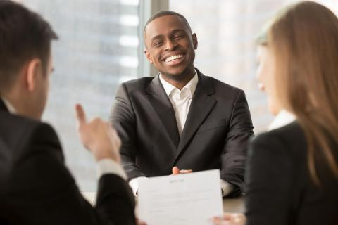 A hiring manager reviewing a successful graduate CV